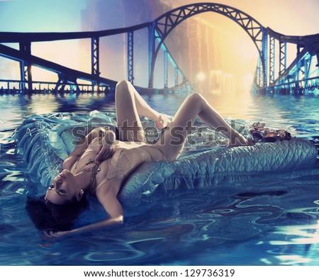 Elegant lady floating on water on city street - stock photo