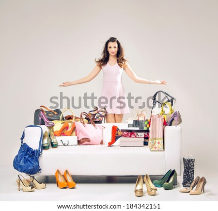 Elegant lady in a room full of fashion accessories - stock photo