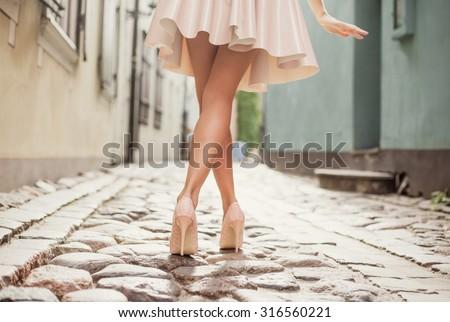 Elegant lady walking alone in the street - stock photo