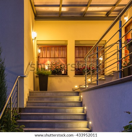 Elegant lighted outside stairs with metal handrail