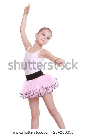Elegant little ballerina in a pink tutu dancing classic ballet isolated on white - stock photo