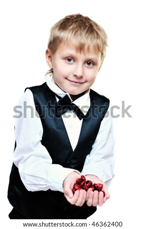 elegant little boy with little red hearts in hands