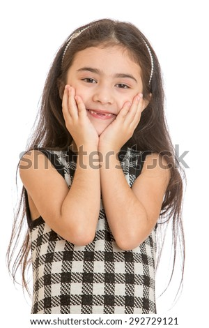 Elegant little dark-haired girl with long hair and plaid fashion dress wrapped your arms around his head, the girl's mouth is missing a few teeth. Closeup - isolated on white background - stock photo
