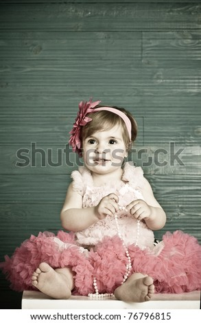 elegant little girl in a bright pink dress - stock photo