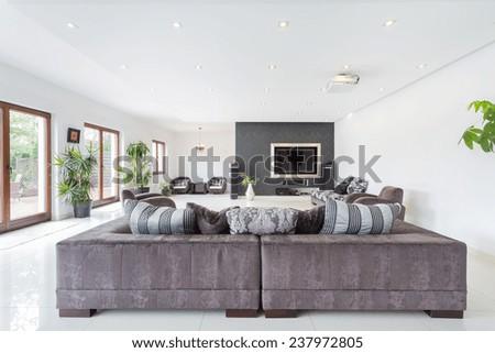 Elegant living room interior in luxury villa - stock photo