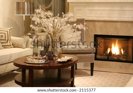 Elegant living room with fireplace on. - stock photo