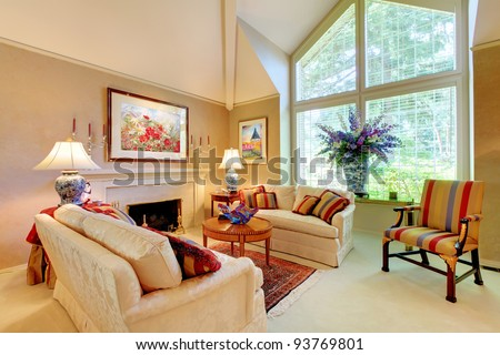 Elegant luxury living room with fireplace and large window. - stock photo