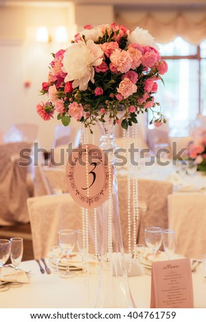 Elegant luxury wedding reception table arrangement, floral centerpiece closeup - stock photo
