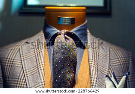 Elegant male suit on shop mannequins high fashion retail display - stock photo