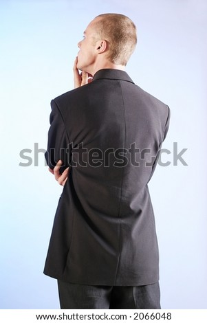 elegant man, businesman in  a suit thinking - stock photo
