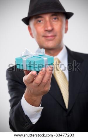 Elegant man holding a present - stock photo