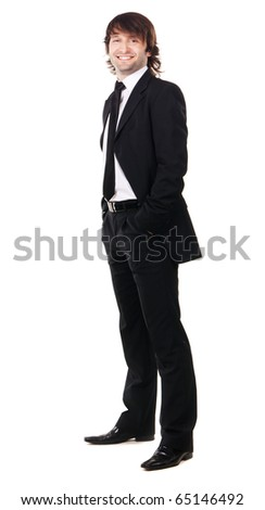 Elegant man in black suit against white background - stock photo
