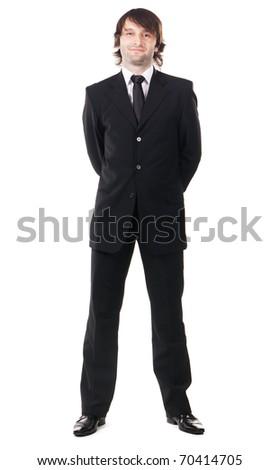 Elegant man in black suit against white background - stock photo