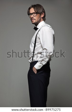 Elegant man in glasses - stock photo