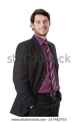 Elegant man in suit holding hands in his pockets - stock photo