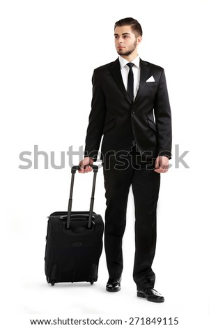 Elegant man in suit with suitcase isolated on white - stock photo