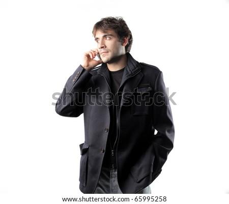 Elegant man using a mobile phone - stock photo