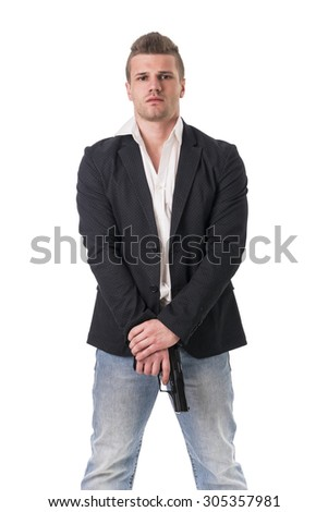 Elegant man with gun, dressed as a spy or secret agent, with earphones, isolated on white - stock photo