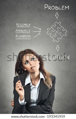 Elegant manager solving a business problem . Grey texture backdrop - stock photo