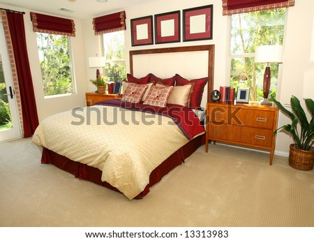 Elegant master bedroom in shades of red - stock photo