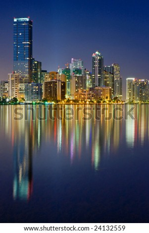 elegant miami florida skyline reflecting in biscayne bay at dusk - stock photo