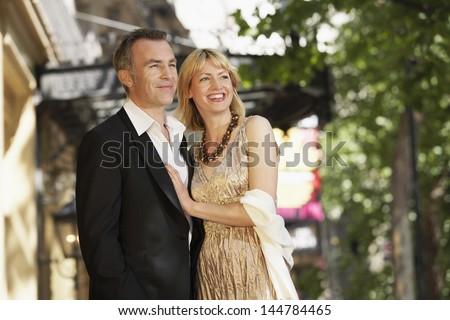 Elegant middle aged couple outside building on London street - stock photo