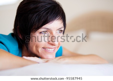 elegant middle aged woman daydreaming - stock photo