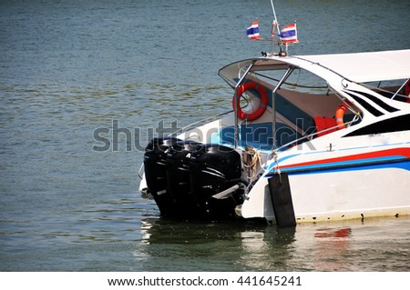 Elegant motor boat sailing at high speed on a sunny day in thailand