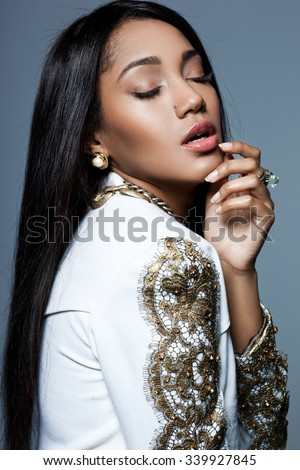 Elegant mulatto girl in a jacket - stock photo