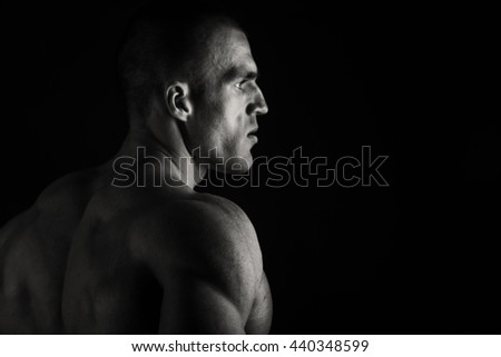 Elegant, muscular male body on black background