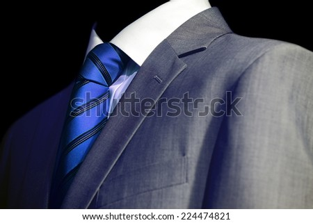 Elegant mysterious businessman in a dark glow - stock photo