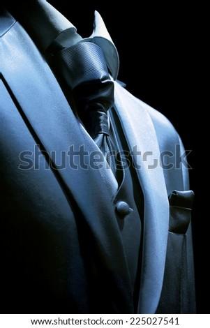 Elegant mysterious businessman in a dark half-glow - stock photo