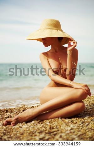 Elegant naked lady at the sea. Summer travel photos - stock photo