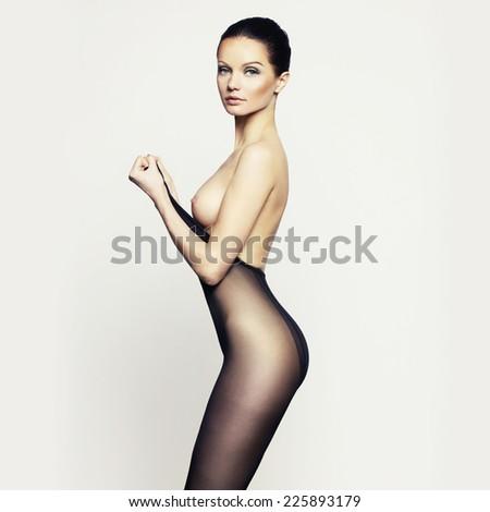 Elegant nude woman in pantyhose. Fashion art photo - stock photo
