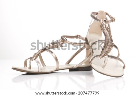 Elegant of Woman's Sandals Shoes isolated on a white background - stock photo