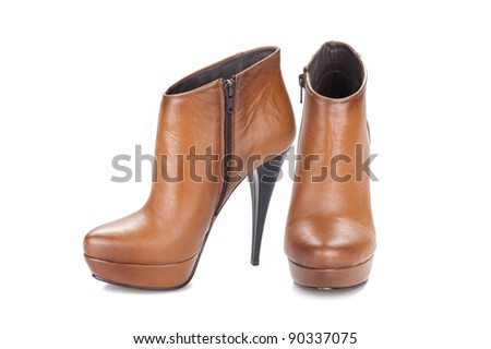Elegant pair of woman's shoes isolated on a white background - stock photo