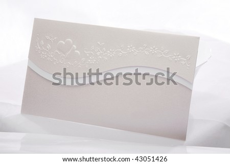 Elegant paper envelope or wedding invitation - stock photo