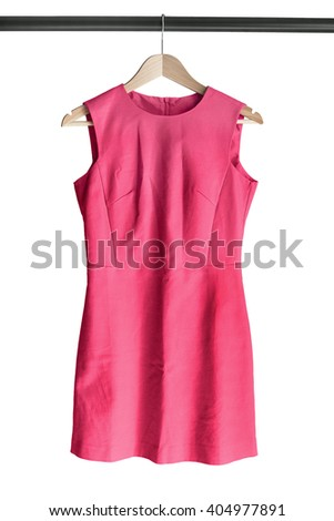 Elegant pink dress on clothes rack isolated over white - stock photo
