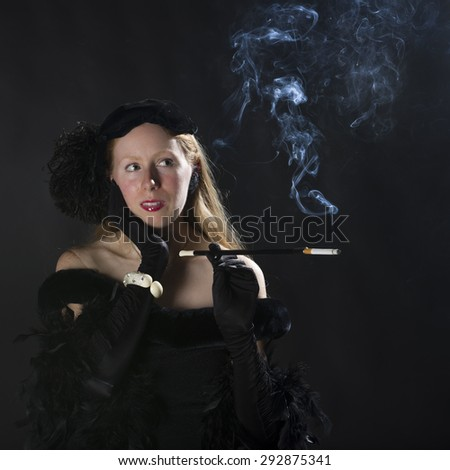 Elegant Portrait of Glamorous Woman Smoking Cigarette and Dressed in Vintage Clothing Looking to the Side with Hand on Face, Waist Up Portrait in 1940s Film Noir Style - stock photo