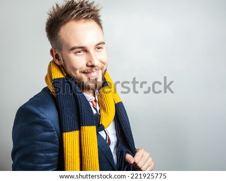 Elegant & Positive young handsome man in colorful scarf. Studio fashion portrait.  - stock photo