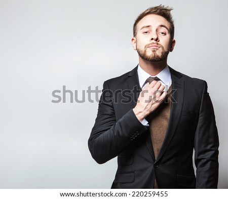 Elegant & Positive young handsome man in costume. Studio fashion portrait.  - stock photo