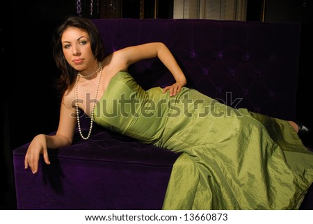 Elegant, pretty young woman in evening dress