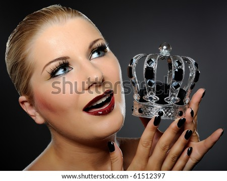 elegant queen female face with red shiny lips and black eye makeup. colse-up. - stock photo