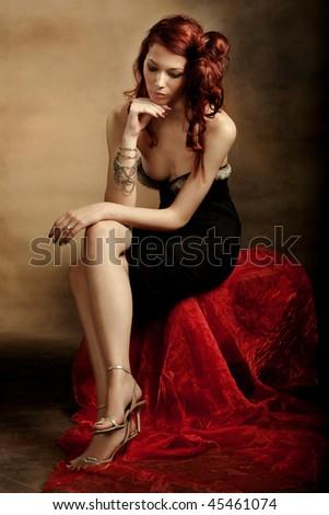 elegant red hair woman, studio shot - stock photo