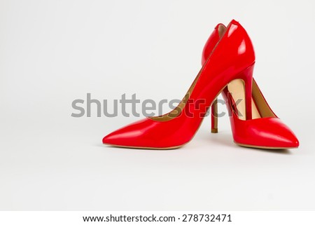 Elegant red patent leather shoes. Sexual trendy women's shoes.