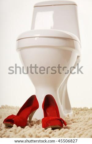 elegant red shoe in toilet - stock photo