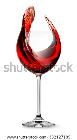Elegant red wine splashing in wineglass isolated on white - stock photo