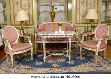 Elegant room with antique furniture - stock photo