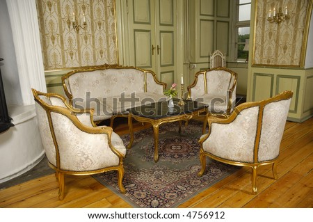 Elegant room with antique furniture - stock photo