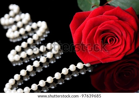 elegant rose with pearls on a black background - stock photo